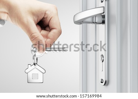hand opened door key house concept - stock photo