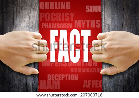 """Hand opening a wooden door found the word """"FACT"""" in the middle of many different words. - stock photo"""