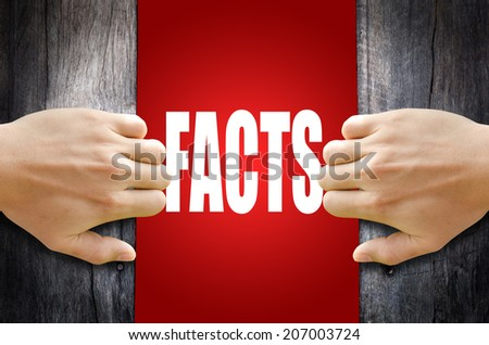 """Hand opening a wooden door found the word """"FACTS"""". - stock photo"""