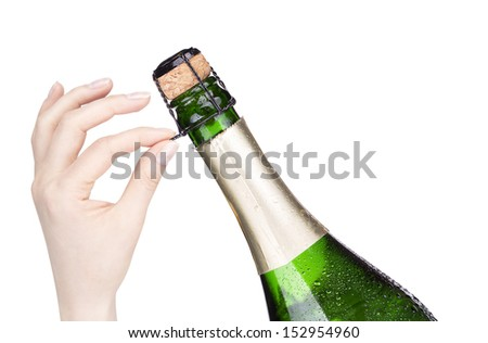 hand opening bottle of champagne on a  white background - stock photo