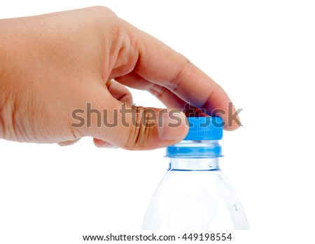 Hand opening bottle of water  - stock photo