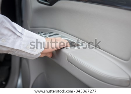 Hand opening car door ,hand on holding a car