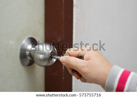 Hand opening door by keyLocking up or unlocking door with key in hand. & Hand Opening Door By Keylocking Unlocking Stock Photo 573755716 ...