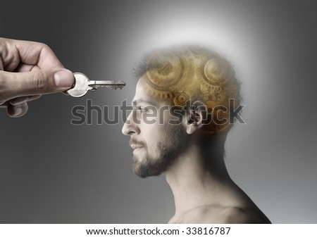 hand opening man's mind with a key