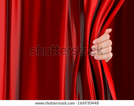 Hand opening red curtain. - stock photo