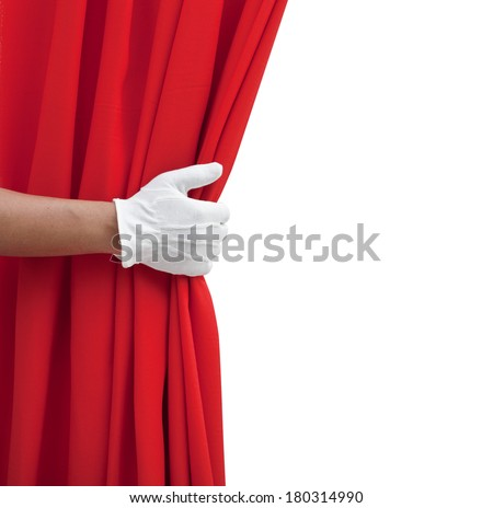 hand opening red curtain on white. - stock photo