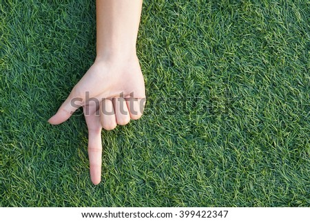 hand over a green grass