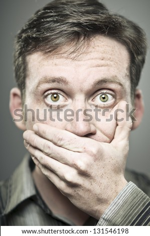 Hand Over Mouth - stock photo