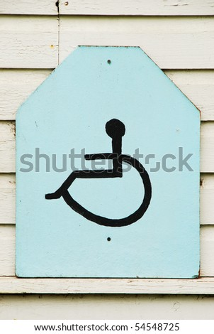 hand painted and carved handicap sign