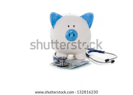 Hand painted blue and white piggy bank sitting on euro notes with stethoscope - stock photo