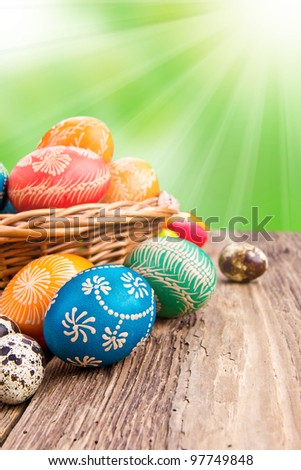 Hand painted easter eggs in basket - stock photo
