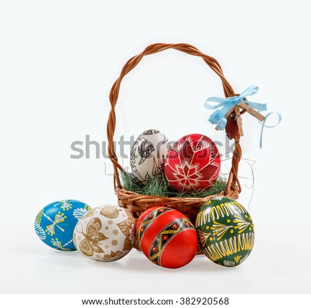 hand painted Easter eggs in the nest on wooden background. Easter table.