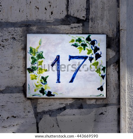 hand painted house number seventeen - stock photo