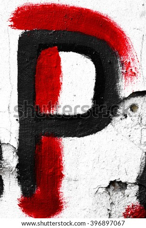 Hand painted letter P on old white wall
