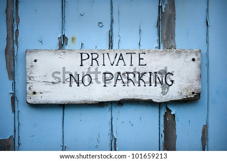 hand painted no parking sign