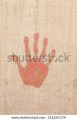 Hand painted on a wall, detail of a hand-print, shape and texture background - stock photo