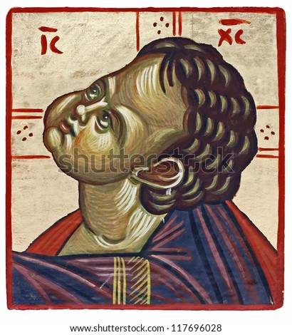 Hand-painted orthodox icon of a young Christ. Egg tempera on wooden board decorated with golden leafs in background - stock photo