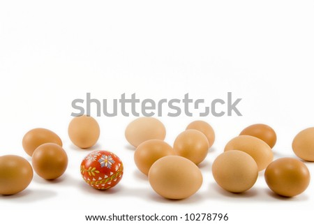 hand painted red egg among natural eggs - stock photo