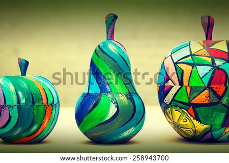 Hand-painted wooden fruit - pears and apples. Handmade, contemporary art - stock photo