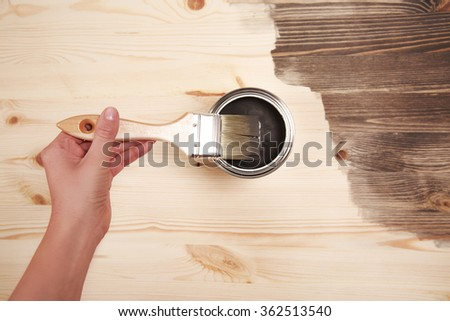 Hand painting on wooden table - stock photo