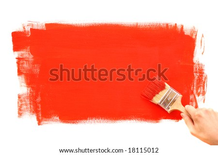 Hand painting the wall with red brush