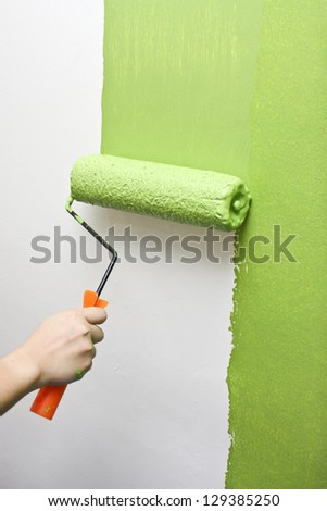 Hand Painting Wall - stock photo