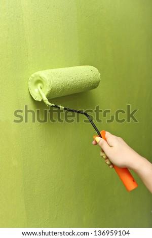 Hand Painting Wall - stock photo