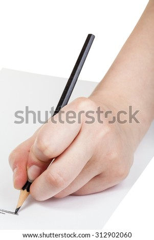 hand paints by black pencil on sheet of paper isolated on white background