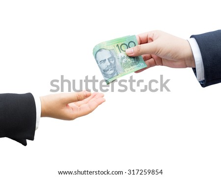 Hand passing money Australian dollar (AUD) banknote in isolated background.