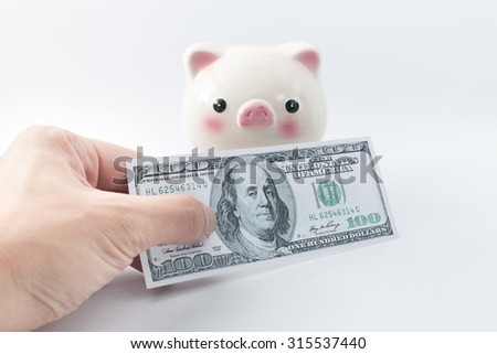 Hand pay money with piggy bank background,saving concept.
