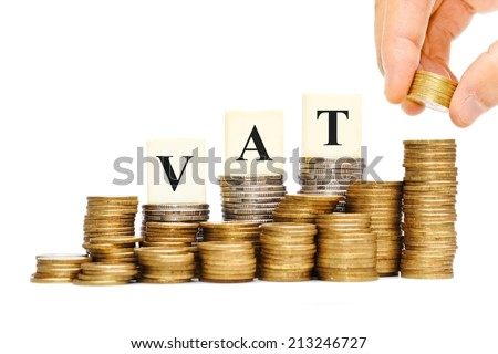 hand paying VAT (Value Added Tax) on Stacks of Gold Coins with isolated background