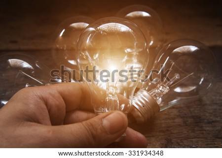 Hand-picked light bulbs - stock photo