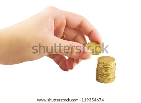 Hand placing coin in the money stack - stock photo