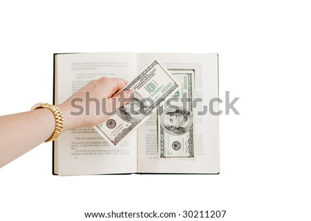 Hand Placing One Hundred Dollar Bill in Prop Book - stock photo
