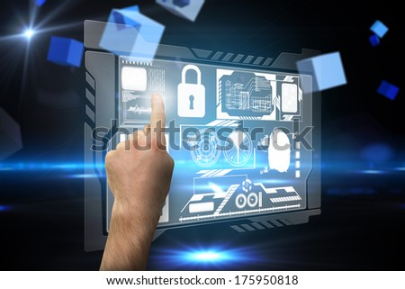 Hand pointing against boxes on technical background - stock photo