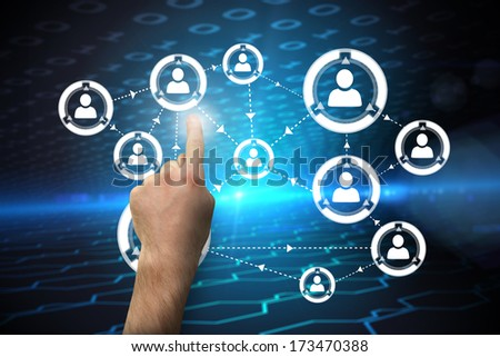 Hand pointing against hexagon pattern on technical background with binary code