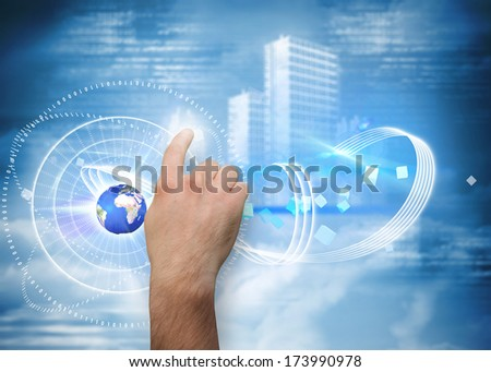 Hand pointing against holographic cityscape in clouds, elements of this image furnished by NASA