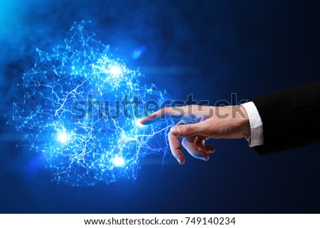 Hand pointing at abstract glowing polygonal sphere on blurry background. Future and innovation concept. 3D Rendering