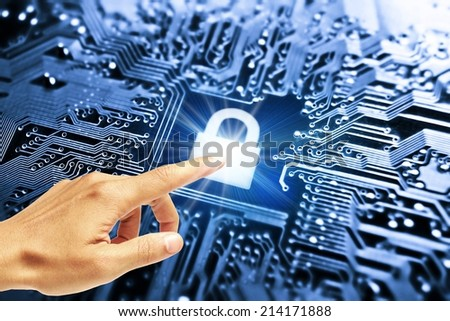 hand pointing at graphic symbol of a lock on a computer circuit board - computer security system - stock photo