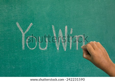 Hand pointing at you win  word of success concept on chalkboard - stock photo