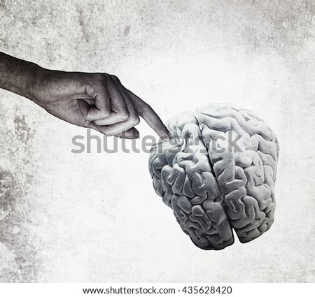 Hand pointing brain diagnosis concept for medical on vintage background - stock photo