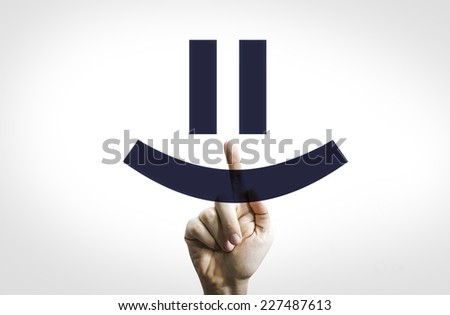 Hand Pointing in a Transparent Board a Smiley