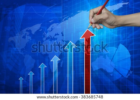 Hand pointing pencil to red arrow head with financial chart and graph on map and city background, Elements of this image furnished by NASA - stock photo