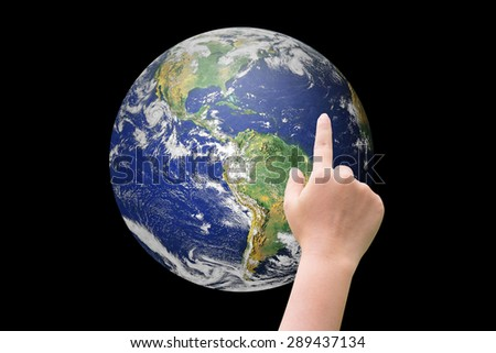 hand pointing the earth isolated on black backgrounds. Elements of this image furnished by NASA - stock photo