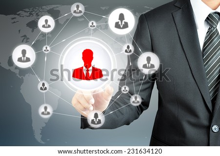 Hand pointing to businessman icon in the middle that linked with each other as network - HR,HRM,HRD, teamwork & leadership concept - stock photo