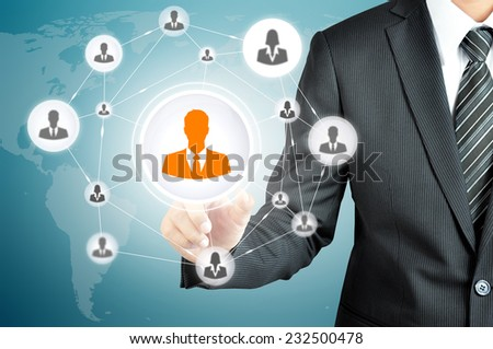Hand pointing to businessman icon in the middle that linked with each other as network - HR,HRM,MLM, teamwork & leadership concept - stock photo