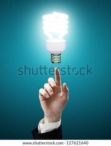 hand pointing to energy saving lamp
