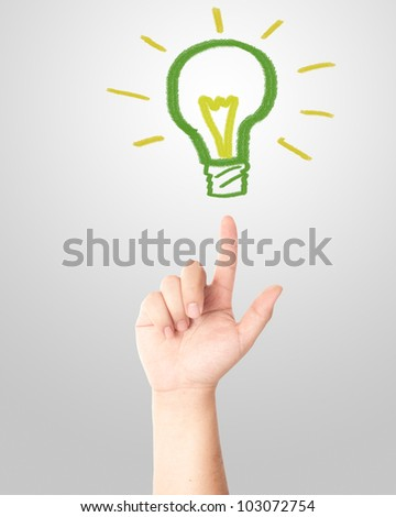 Hand pointing to the hand draw green light bulb. Concept for new idea - stock photo