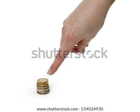 Hand pointing to the pile of coins on white background