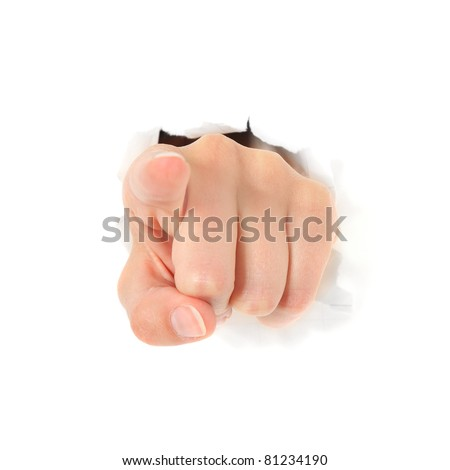 Hand pointing with finger out of torn hole in white wall. All on white background. - stock photo